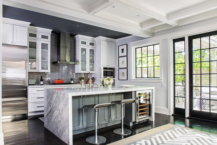 The revamped kitchen is outfitted with Bertch cabinets and Carrara marble counters.