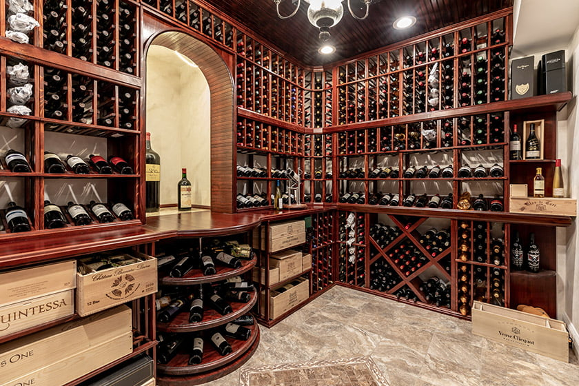 A national COTY award went to a basement with a lavish wine cellar by Michael Nash Design, Build & Homes.