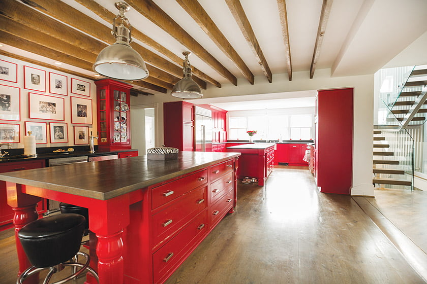 Custom cabinetry transformed the original kitchen; it extends into a newly constructed beverage area.