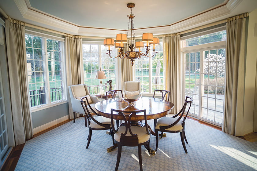 A light-filled bay in the dining room overlooks the garden.