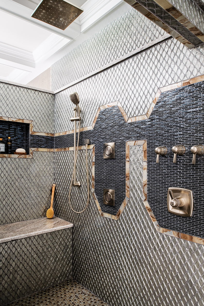 In the shower,  Friend applied a curated selection of glass and mosaic tile to dazzling effect.