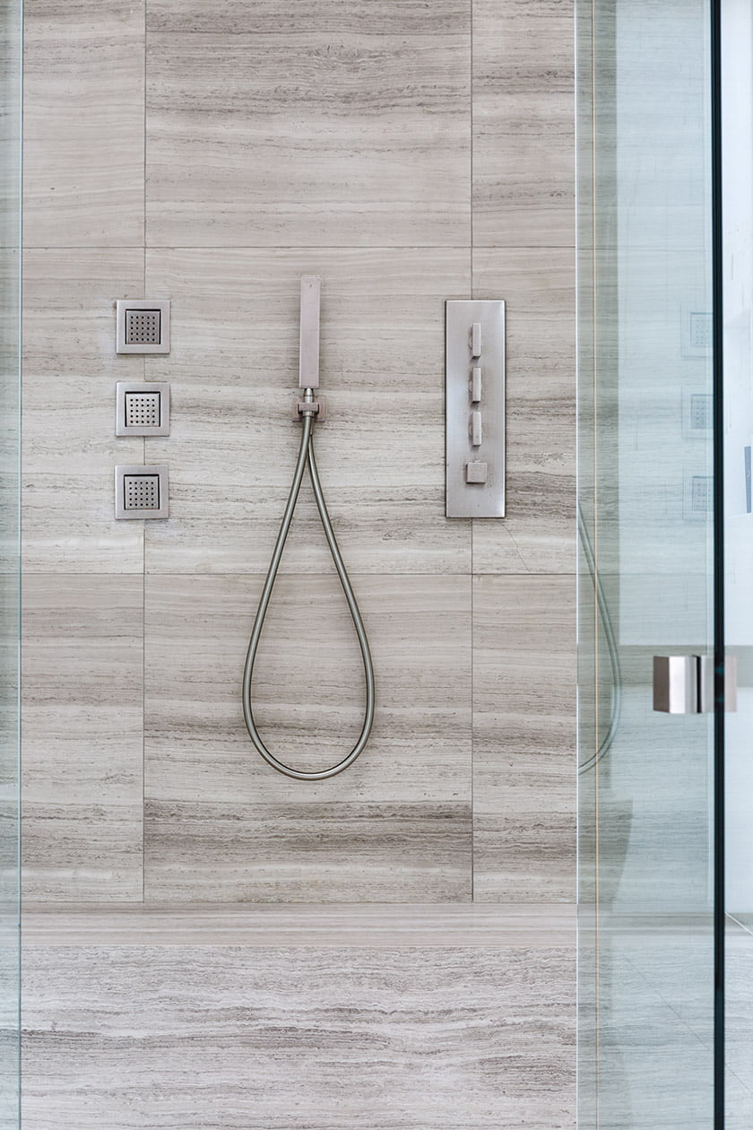 The large steam shower is outfitted with Gessi fixtures.