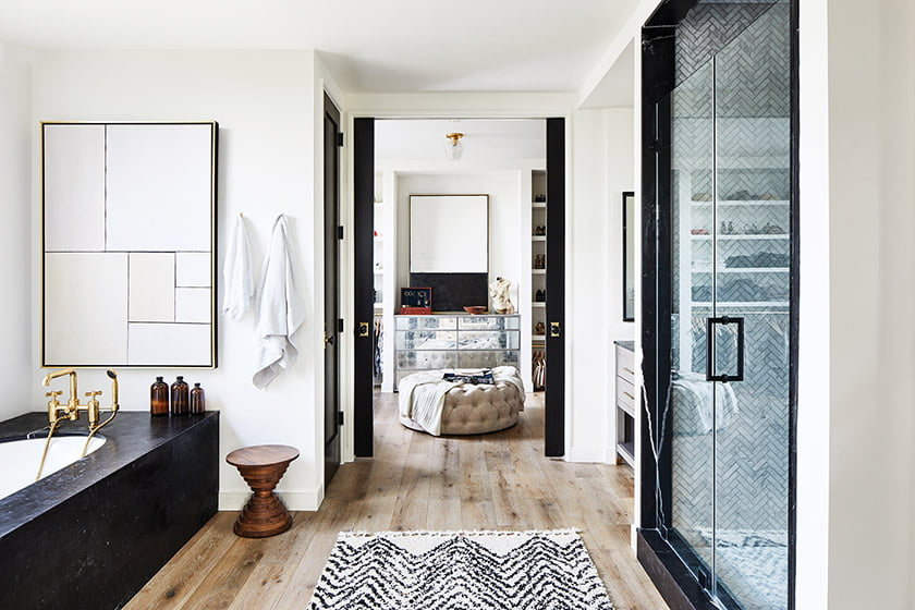 Wide-plank oak floors extend even to the master bath.  A mirrored chest placed on axis anchors the dressing room.