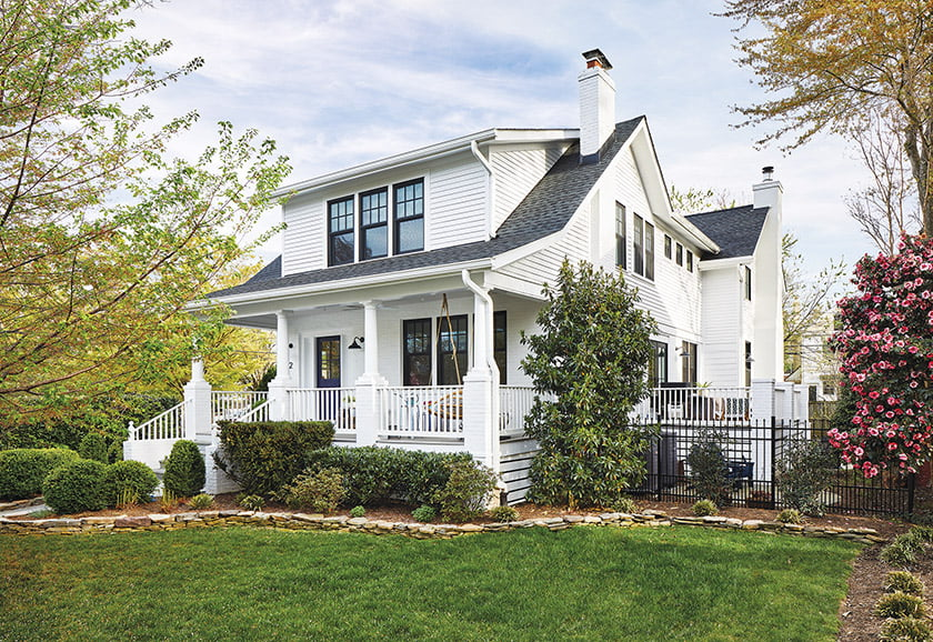 Perched on a corner lot, the house beckons with its welcoming front porch.