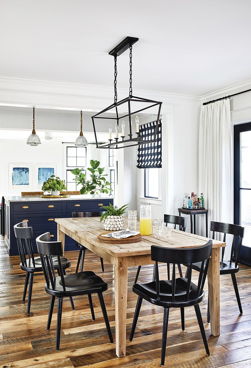 The kitchen flows into the dining room, which centers on an RH farmhouse table.