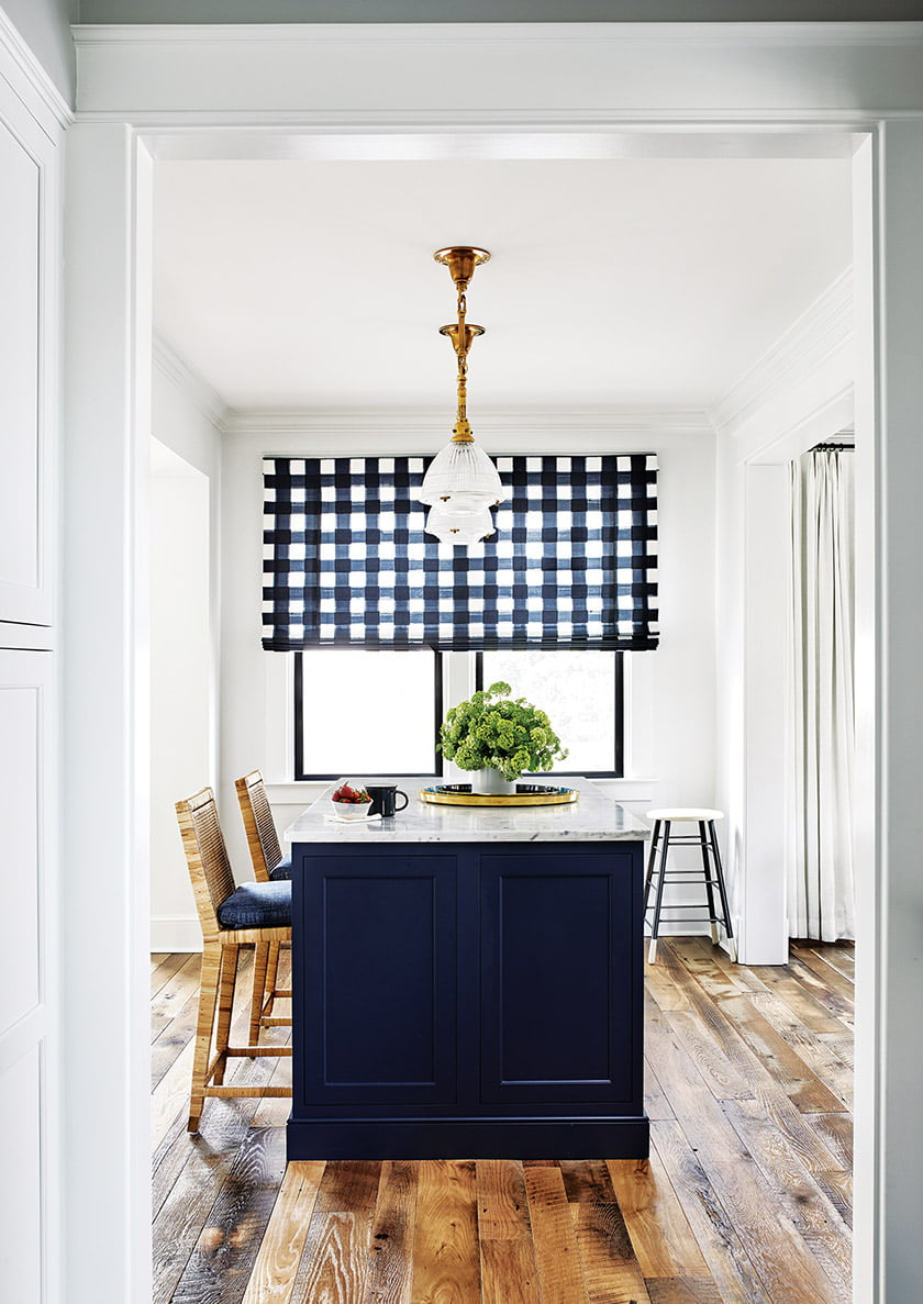 The island room is distinguished by a window shade in Caitlin Wilson gingham.
