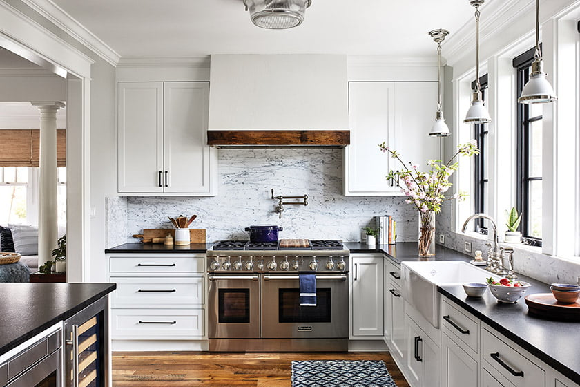 The bright, spacious kitchen features a custom hood above the Thermador range.