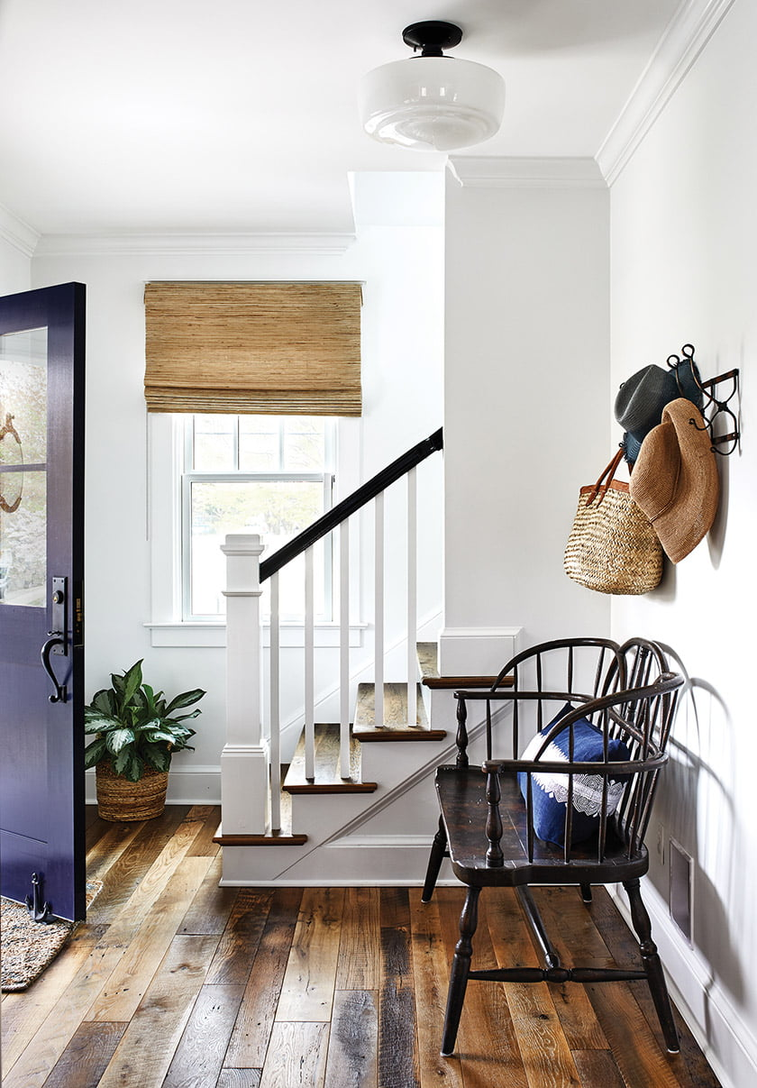In the front entry, a wooden bench occupies the wall that once held the hall closet.