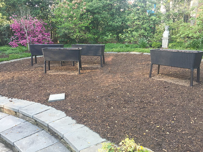 The planters stand on a carpet of mulch thanks to Clifton, Virginia, landscaper Mike Toth.