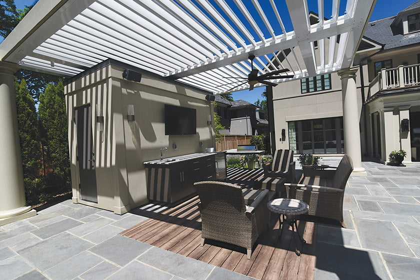 A pergola with a louvered roof by Fine Earth Landscape. Photo: Hilary Schwab