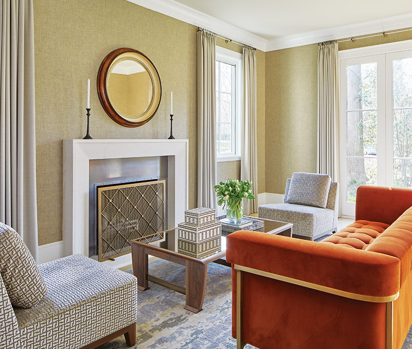 A Holly Hunt sofa adds a pop of color to the living room.