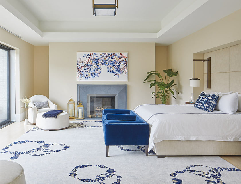 In the master bedroom, a custom Nancy Caperton bed tucks into an upholstered niche with integrated sconces.