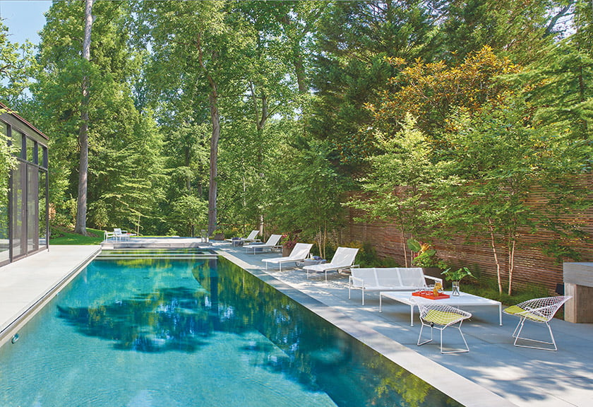 A new state-of-the-art gym opens to the pool; loungers are from JANUS et Cie.