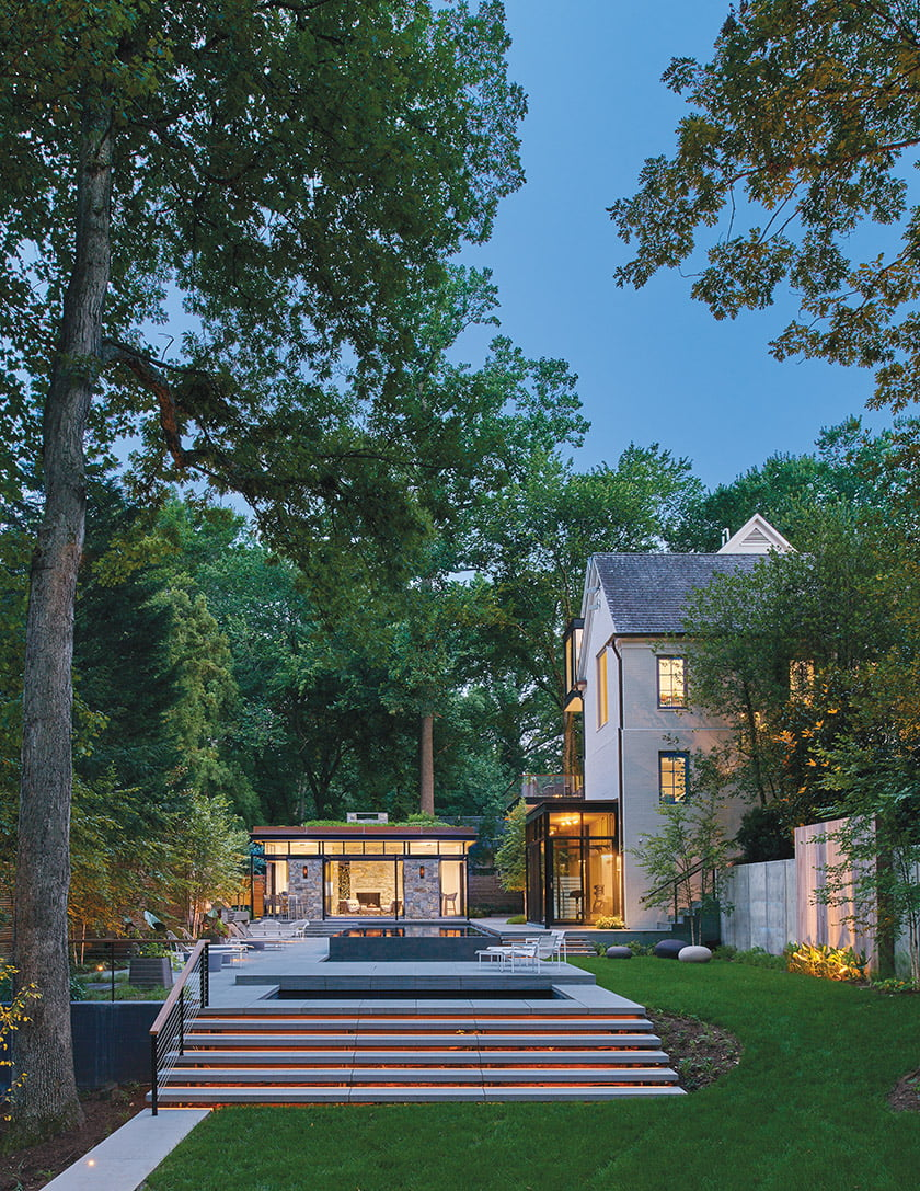 In the backyard, the modern pool house beckons.
