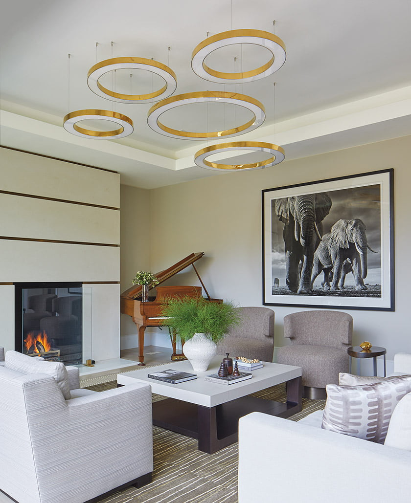 Halo lights by Cameron Design House preside over the family room.