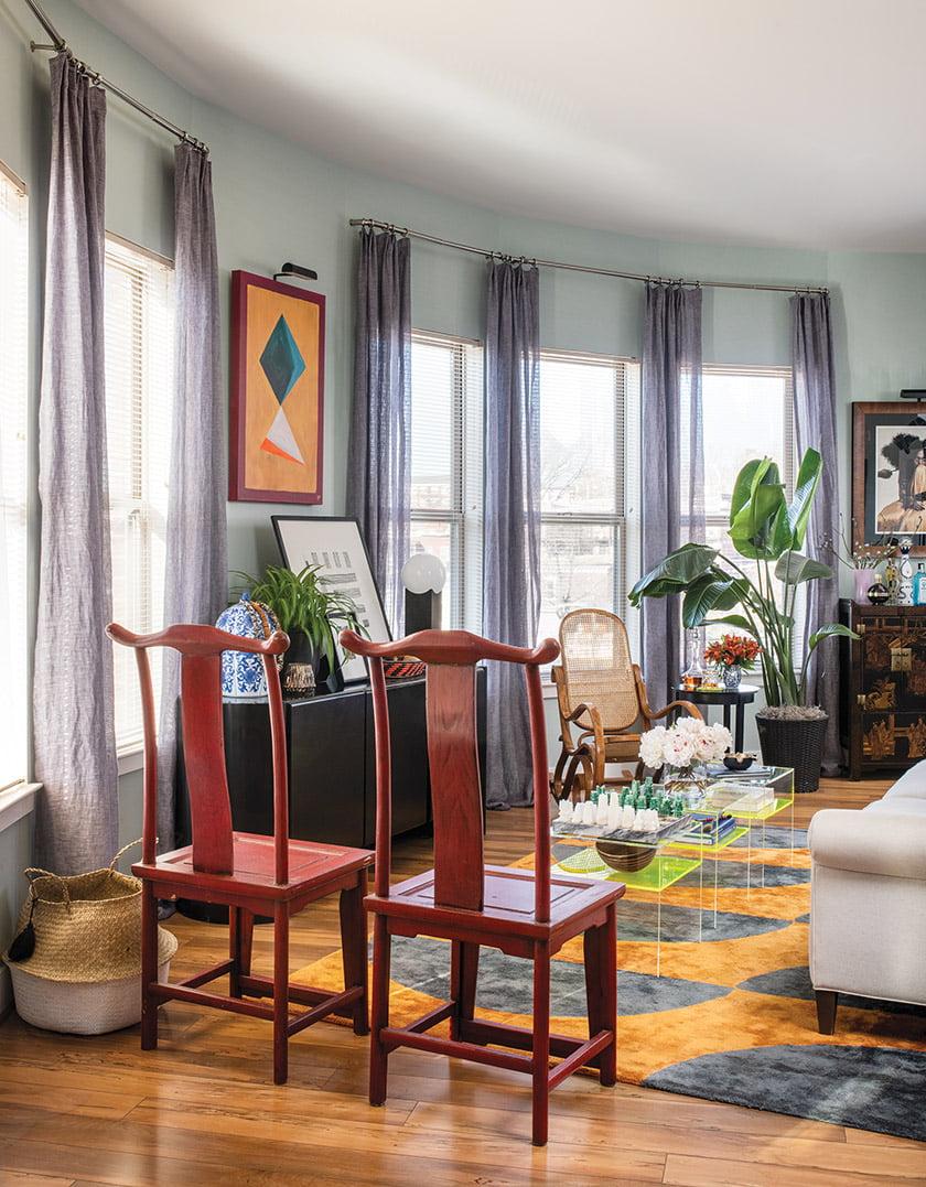 Linen Kirkby Design sheers frame tall windows near abstract art by Powell.