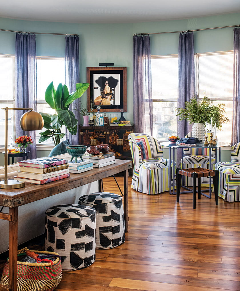 Dining chairs in a graphic Christian Lacroix stripe inspired her exuberant color scheme.