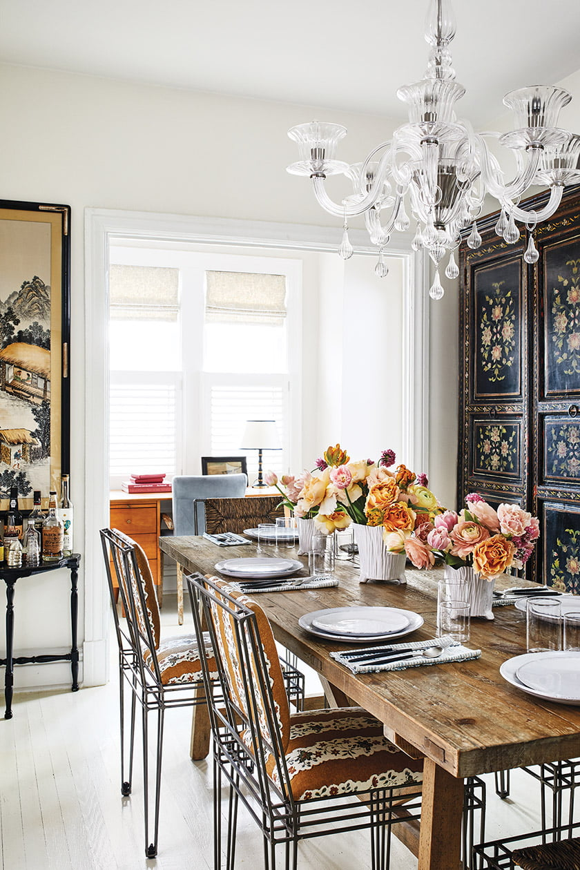 Colgan paired a rustic Clubcu table with Casamidy chairs in her dining room.