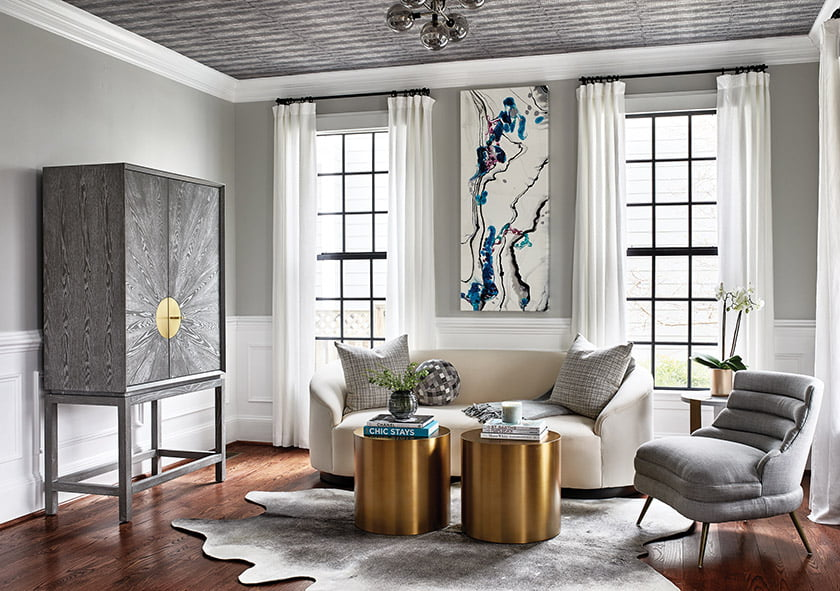 Berger overhauled a Bethesda home, creating an inviting lounge with Arteriors seating and a Worlds Away bar cabinet.