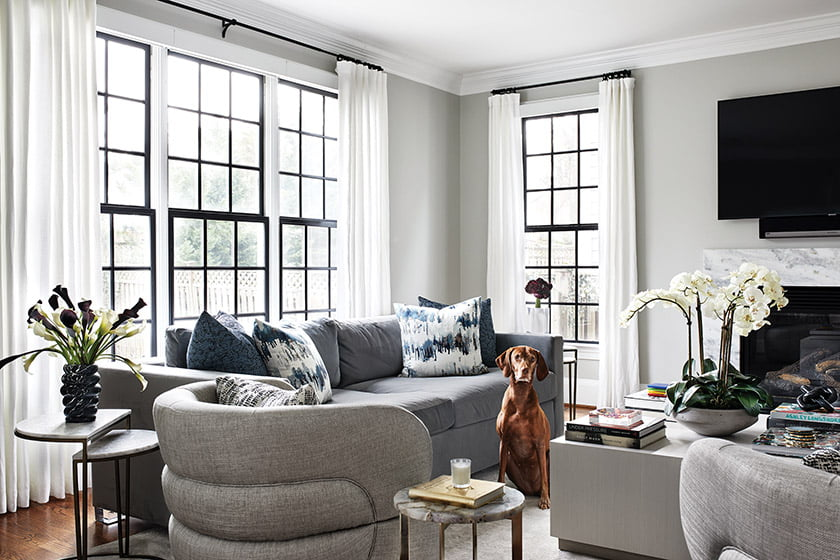 Comfy Scout Design Studio swivel chairs and ModShop sofas create an inviting vibe in the family room.