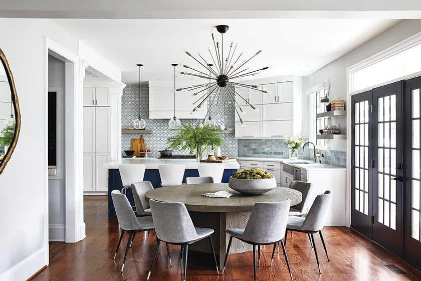 The enlarged kitchen boasts Bertch cabinetry and a backsplash from Architectural Ceramics.