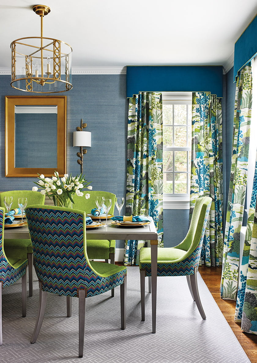 The dining room's Cowtan & Tout grass-cloth wall covering complements Thibaut drapery panels.