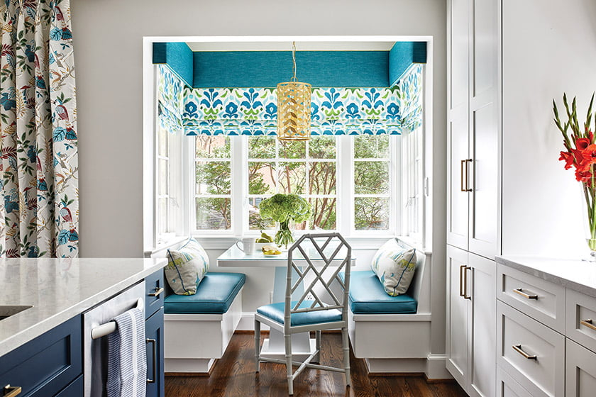 Hickok redesigned a dated Colonial with a fresh palette of blues and greens that enlivens the breakfast nook.