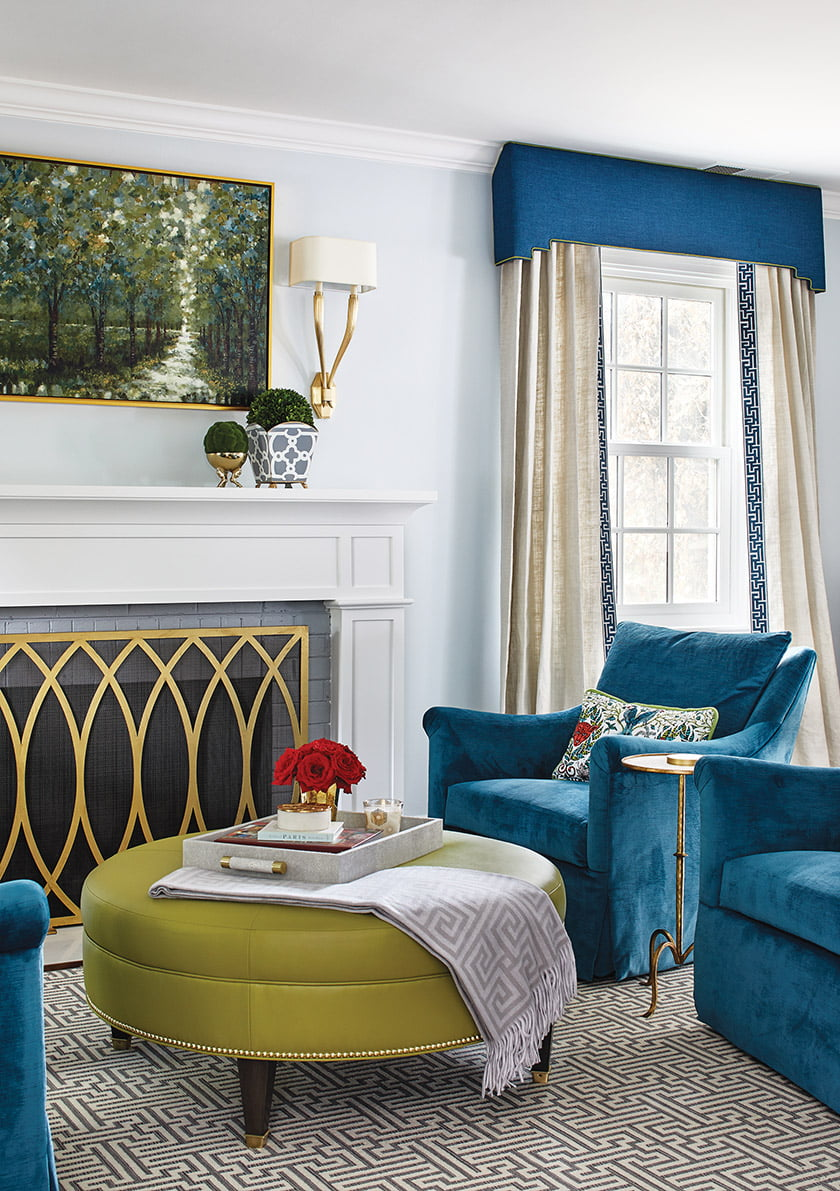Chairs in Pindler velvet and a Hickory Chair ottoman grace the living room.