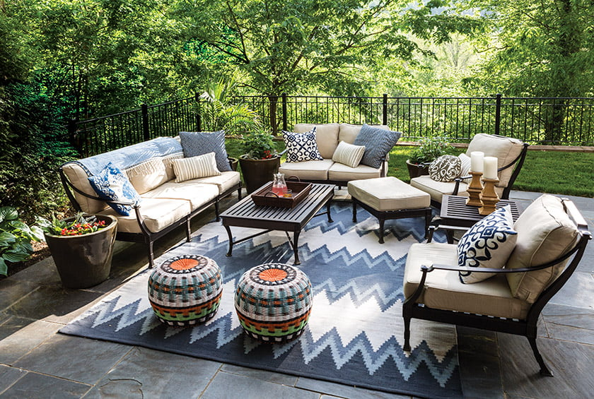 Tracy Schlegel populated her patio with RH outdoor furniture and Serena & Lily poufs.