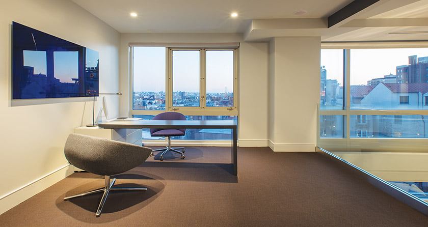 One of the apartment's two bedrooms is now  an office furnished with a Poliform desk and a Wok Lounge Chair.