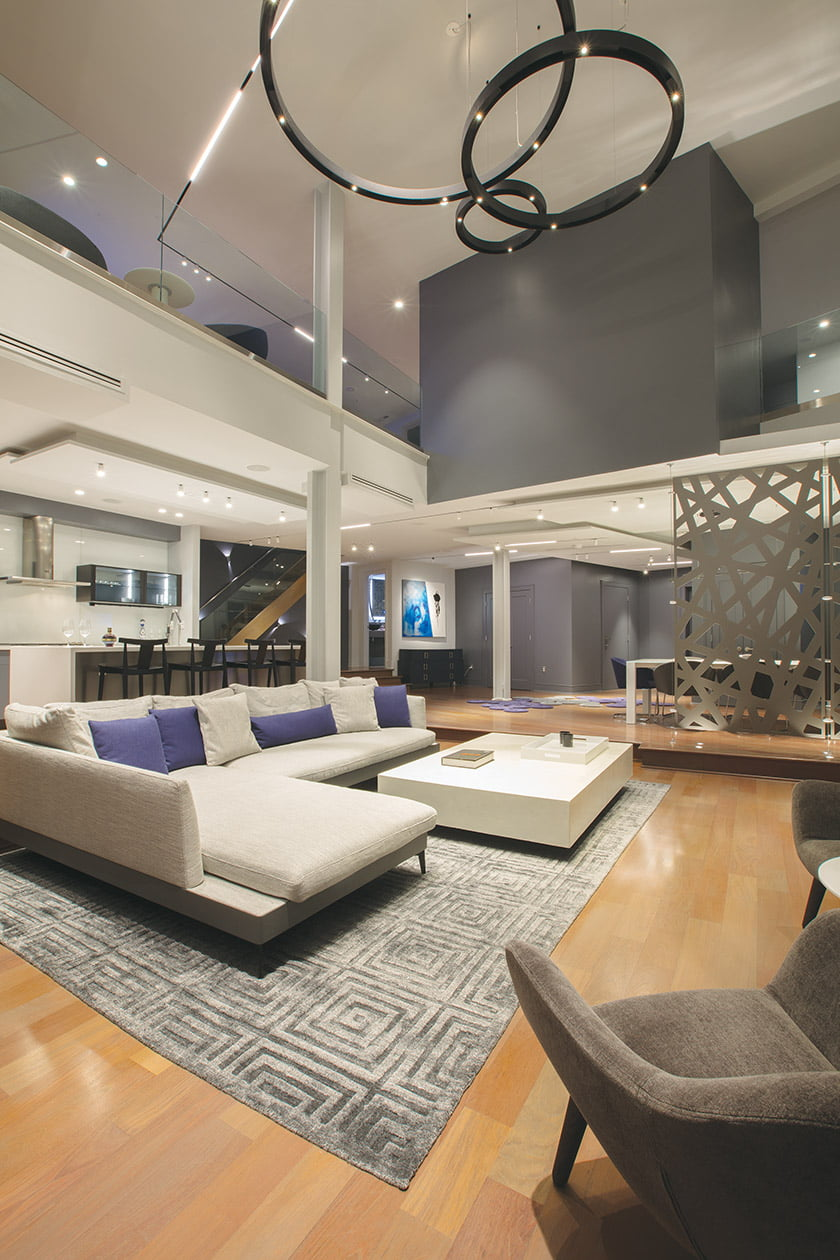Similar lights traverse the ceiling to the loft, unifying the home's two levels.