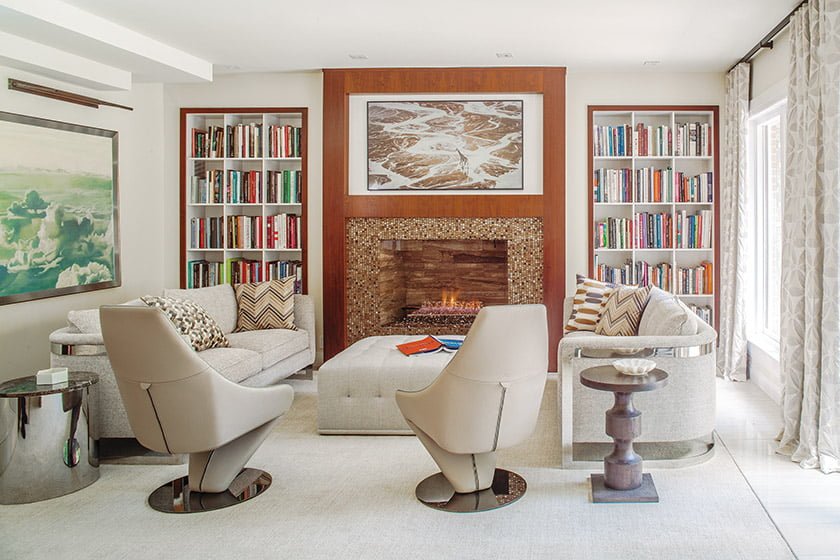 The garden room features Bernhardt sofas and Italian leather chairs.
