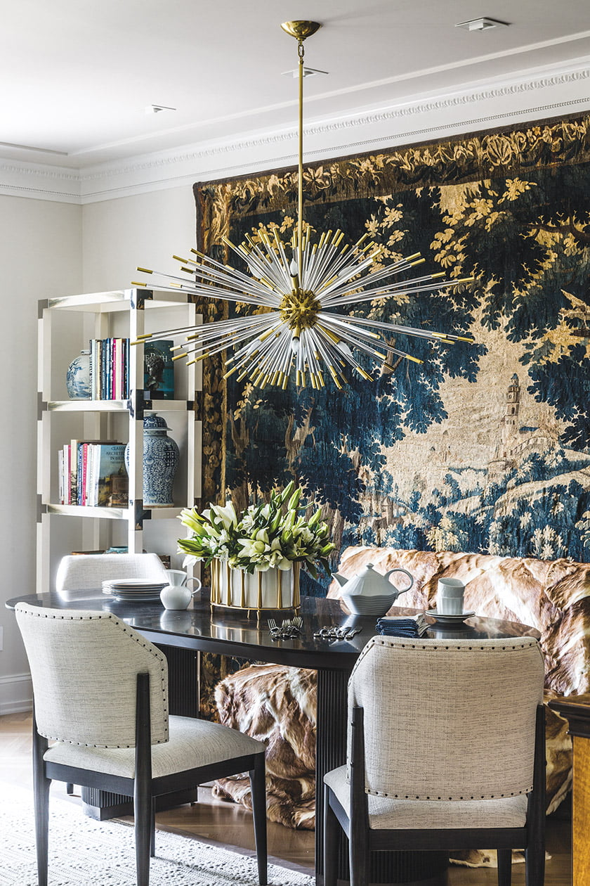 An antique French tapestry weaves its own atmosphere in the dining area.