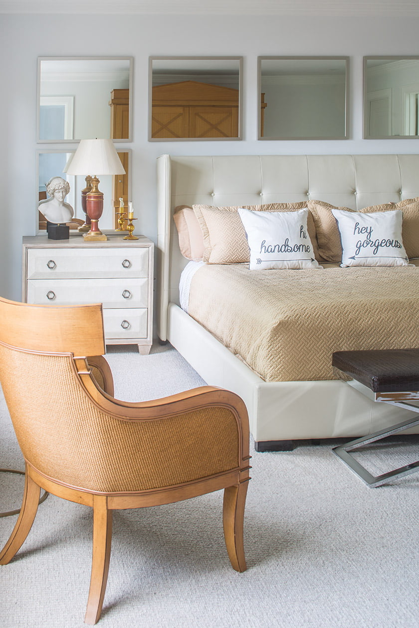 The master bedroom is anchored by a bedstead from Sunpan and leather-covered nightstands.