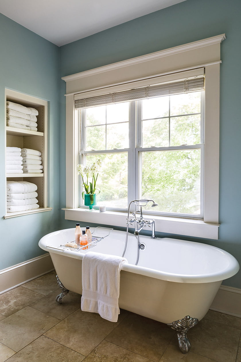 The master bathroom promotes pampering with a clawfoot soaking tub by Elizabethan Classics.