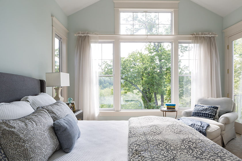 The serene master bedroom features a vaulted ceiling with a 14-foot peak.