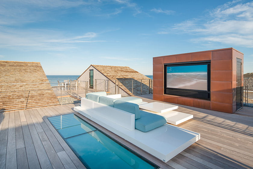 A roof deck on the Rehoboth residence features a built-in TV and plunge pool. Photo: John Cole