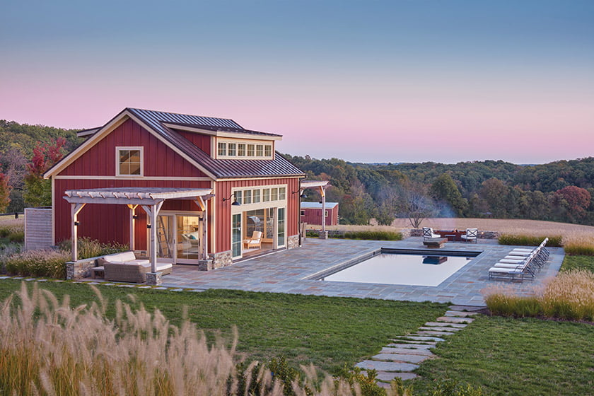 Inspired by classic red-barn vernacular, the pool house sits easily in Maryland farm country.