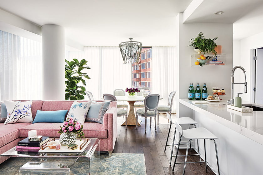 A Kristin Drohan sectional and nesting acrylic coffee tables invite easy entertaining.