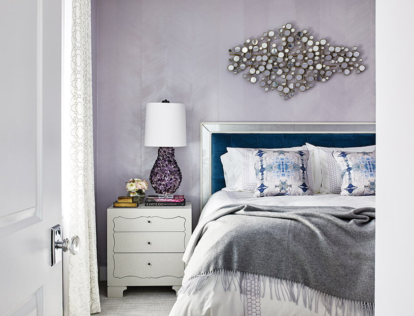 In the guest room, handmade Stacey Tranter wall covering creates a shimmery backdrop for the Vanguard bed.