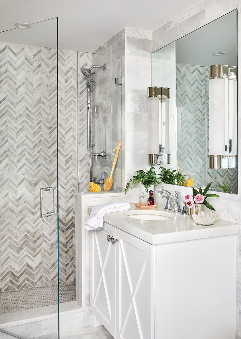 Tile from Marble Systems and Visual Comfort sconces add a dose of luxury to the master bath.