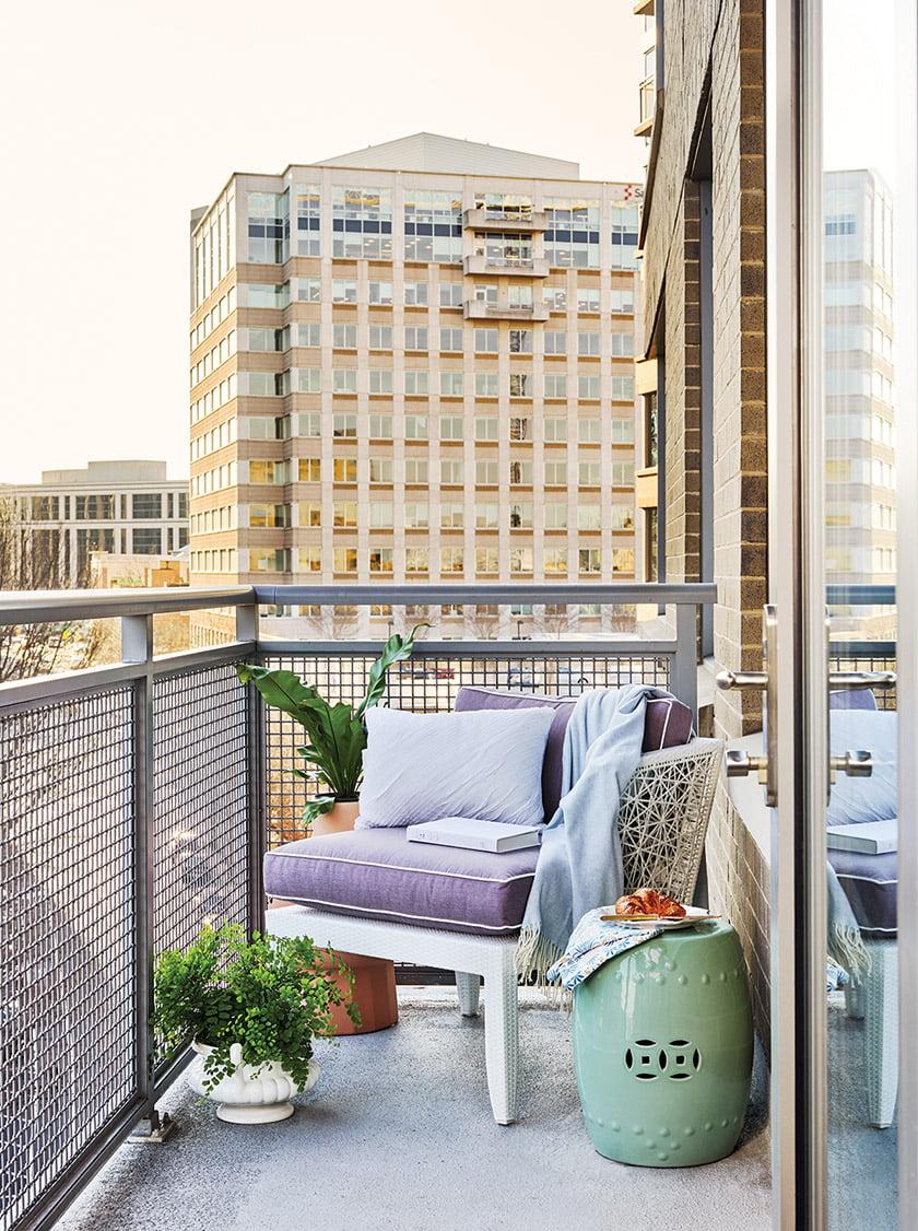 A David Francis Mykonos chair in Sunbrella canvas makes a chic outdoor perch.
