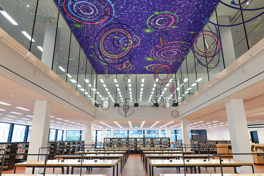 The grand reading room rises to an installation by artist Xenobia Bailey entitled