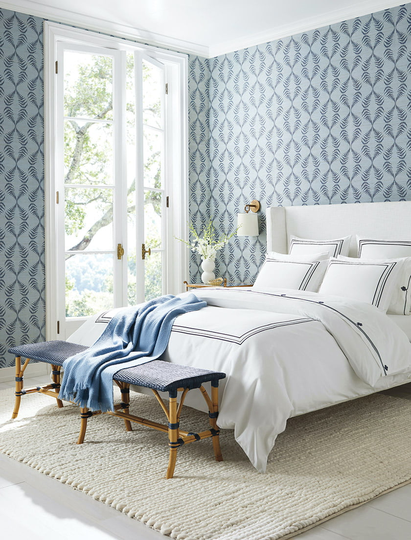 The Tall Broderick Bed with Soho Duvet Cover and Sunwashed Riviera Backless Bench.