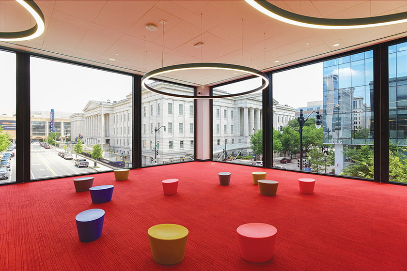Pint-sized stools and playful light fixtures await young patrons in the Children's Library.