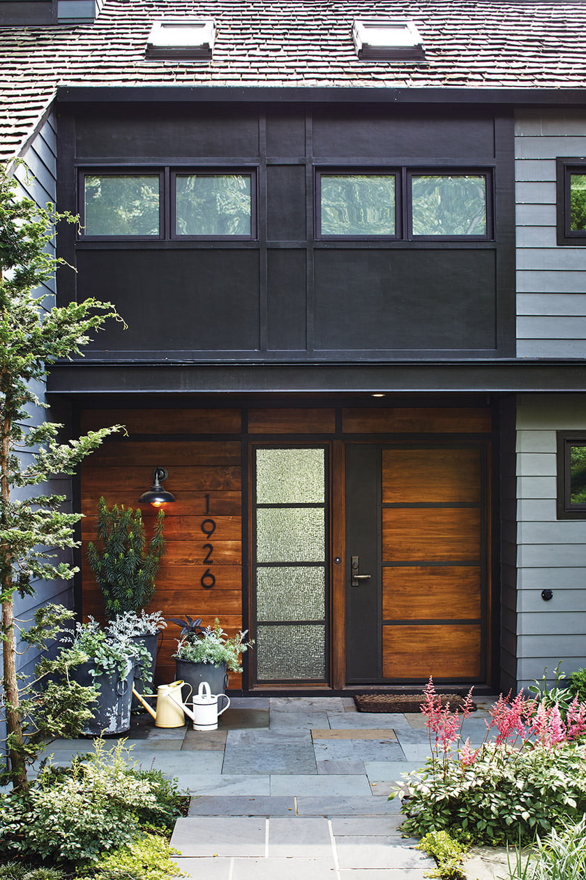 The redesigned entryway boasts a walnut door and side panel. Photo: Stacy Zarin Goldberg