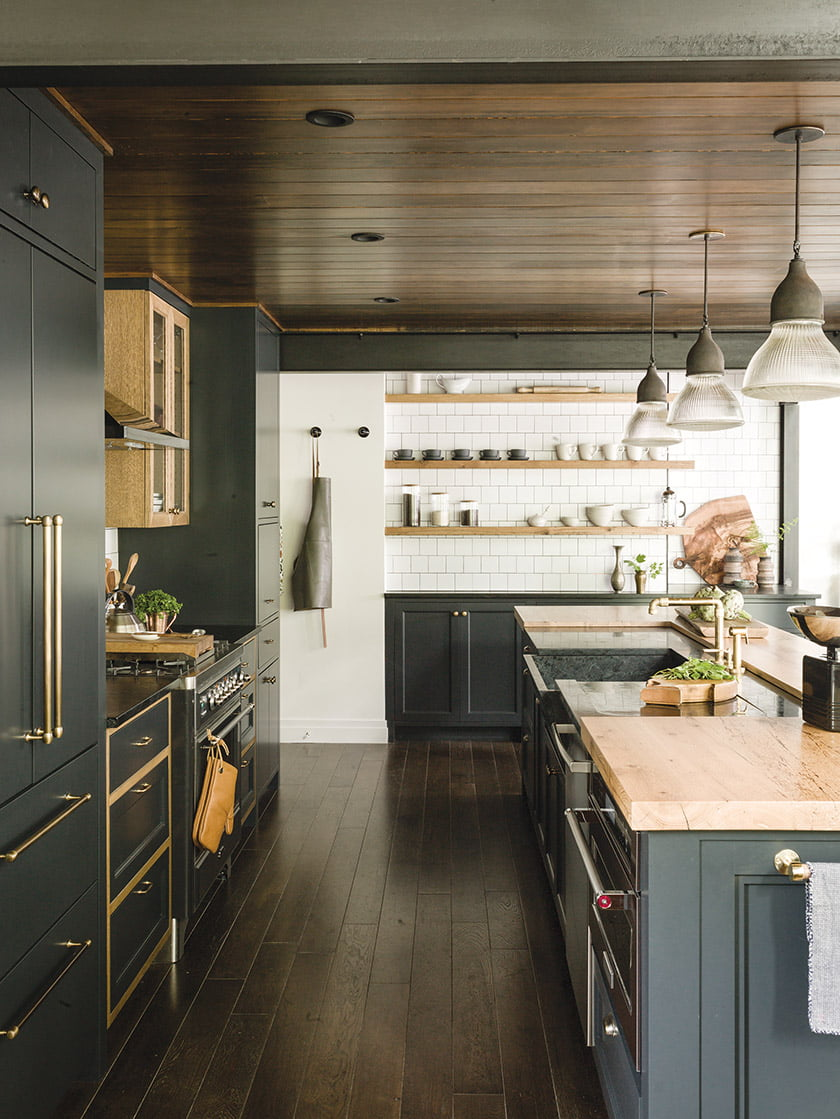 The square, white backsplash tiles in the kitchen riff on turn-of-the-century subway style.