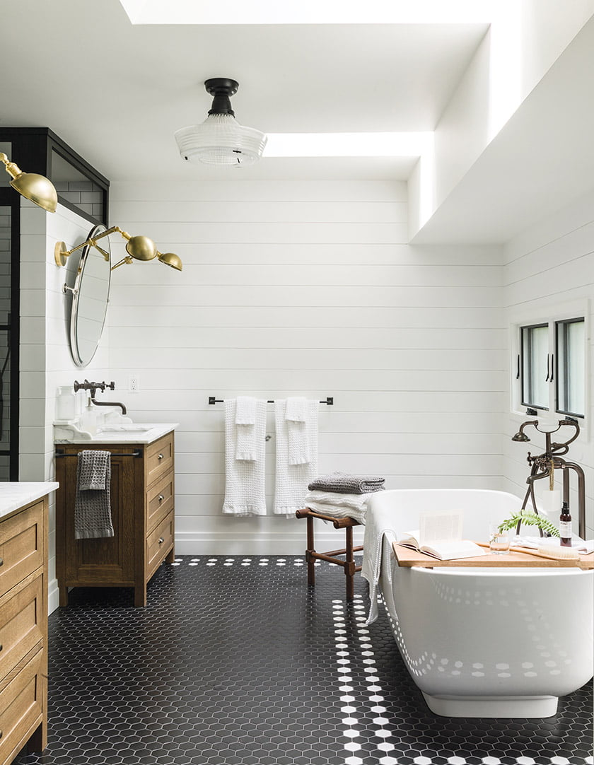 Liess enlivened the master bathroom with black-and-white, hexagonal floor tile from Architectural Ceramics.
