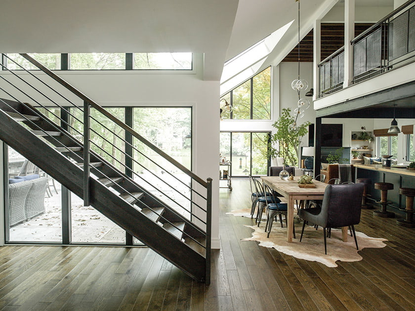 Soaring windows frame views of Lake Thoreau. The staircase was inspired by an early-1900s design.