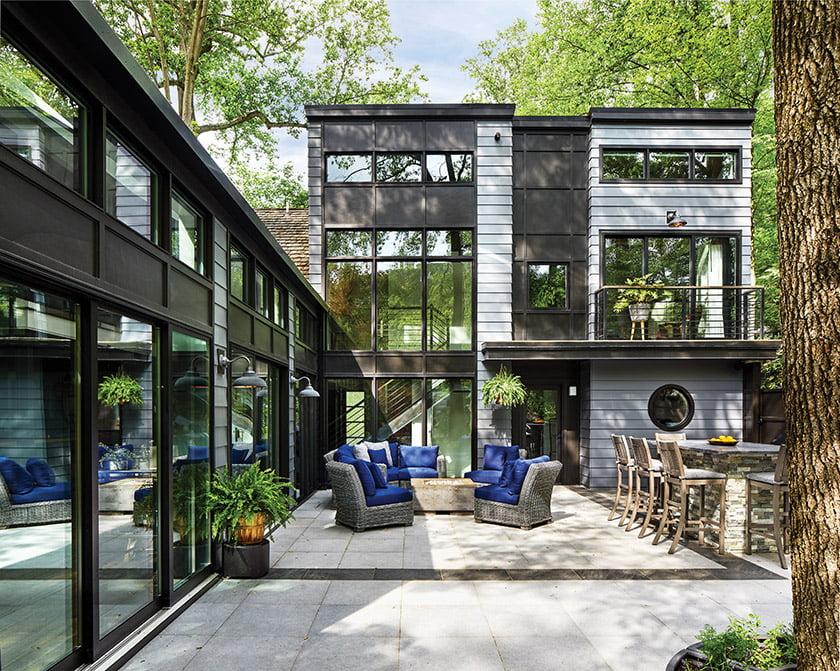 HardiePlank lap siding and aluminum-clad windows and sliding doors update the exterior. Photo: Stacy Zarin Goldberg